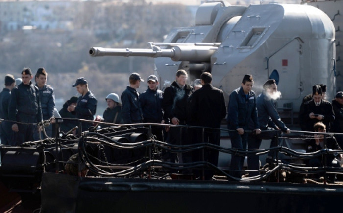 Ukrainian soldiers stand guard on board the navy corvette Ternopil as Russian forces patrol nearby in the harbor of the Ukrainian city of Sevastopol on March 5 2014. Picture: AFP.