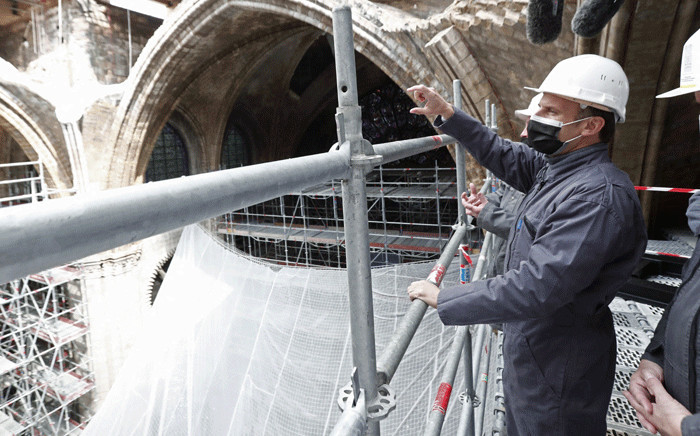 French President Emmanuel Macron looks on during a visit of Notre-Dame de Paris Cathedral marking two years since the blaze that made the spire collapsed and destroyed much of the roof, in Paris on April 15, 2021. Picture: POOL / AFP.