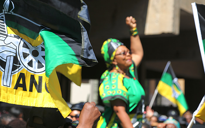 An ANC Women's League member holds her fist in the air during a march to the Union Buildings in Pretoria in 2015, in defence of President Jacob Zuma. Picture: Reinart Toerien/EWN.