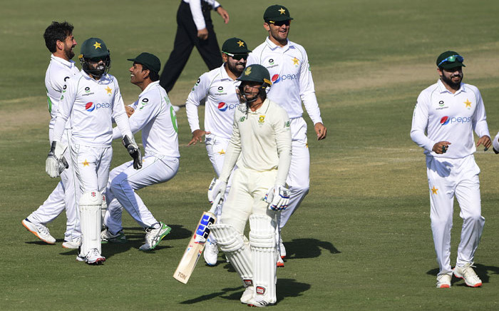Pakistan's players celebrate after the dismissal of South Africa's captain Quinton de Kock (C) during the fourth day of the first cricket Test match between Pakistan and South Africa at the National Stadium in Karachi on 29 January 2021. Picture: Asif Hassan/AFP
