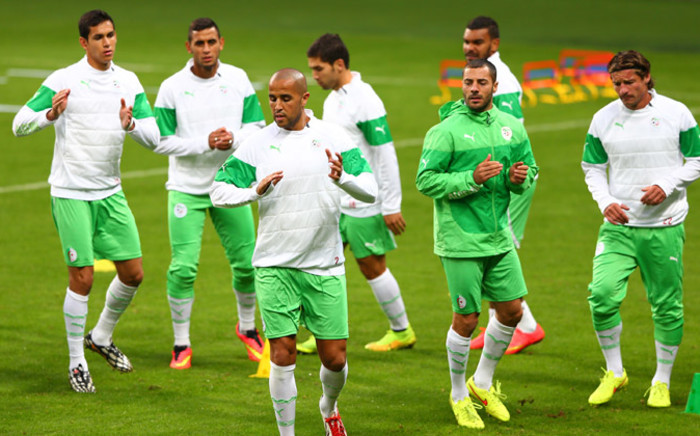 Algeria's footballers jog during a training session on the eve of their Brazil 2014 Fifa World Cup Round of 16 football match against Germany. Picture: AFP.