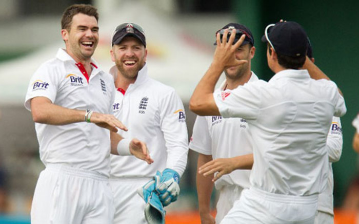 England's James Anderson (L) celebrates with team mates captain Alastair Cook (R) Nick Compton and keeper Matt Prior after New Zealand's Peter Fulton was caught out during day four of the international cricket Test match with New Zealand on March 17, 2013. Picture: AFP/Marty Melville
