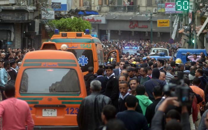 FILE: Egyptians gather at near a church in Alexandria after a bomb blast struck worshippers gathering to celebrate Palm Sunday on 9 April 2017. Picture: AFP.