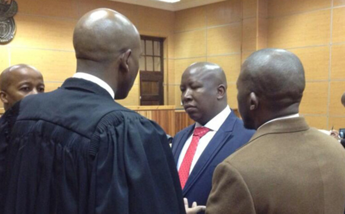 Julius Malema and his legal team in the Polokwane Magistrates Court on 21 June. Picture: Barry Bateman/EWN