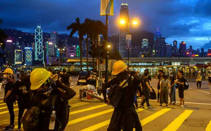 FILE: Protesters gather in Tsim Sha Tsui in Hong Kong on 3 August 2019, in the latest opposition to a planned extradition law that has evolved into a wider movement for democratic reforms. Picture: AFP