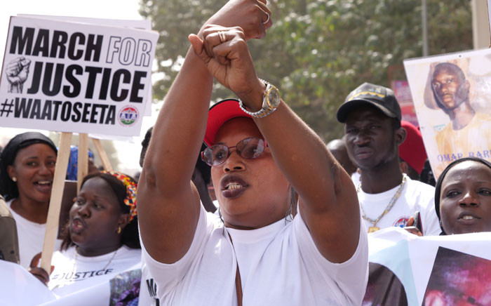 A relative of one of the victims of the regime of Yahya Jammeh, the former President of the Gambia, gestures during a demonstration asking for Yahya Jammeh to be brought to justice in Banjul on 25 January 2020. Picture: AFP