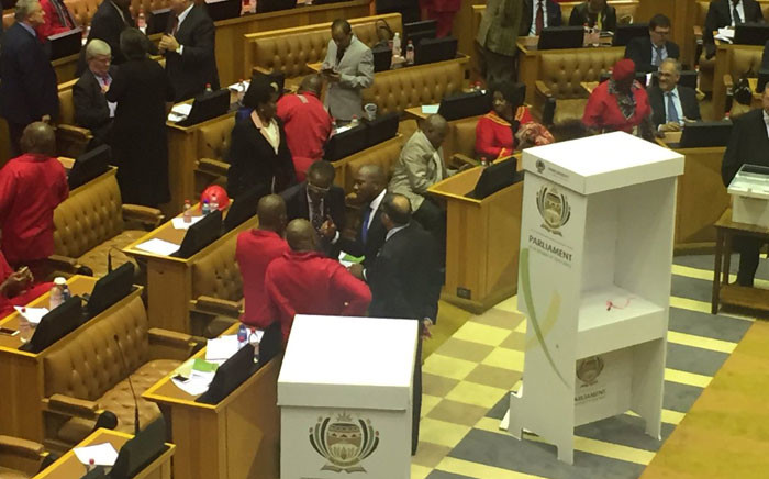 Leaders of opposition parties having a discussion in Parliament ahead of voting in the motion of no confidence in President Jacob Zuma. Picture: Lindsay Dentlinger/EWN.