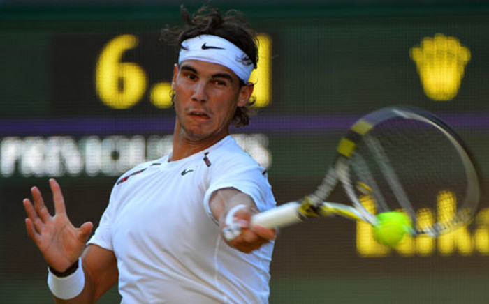 Spain's Rafael Nadal plays a forehand shot during his second round men's singles match against Czech Republic's Lukas Rosol at the 2012 Wimbledon Championships on 28 June, 2012. Picture: AFP