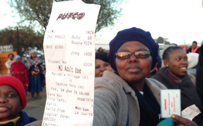 A bus commuter holds up her Putco bus ticket in Mamelodi, Wednesday 1 July 2015. Picture: Vumani Mkhize/EWN.
