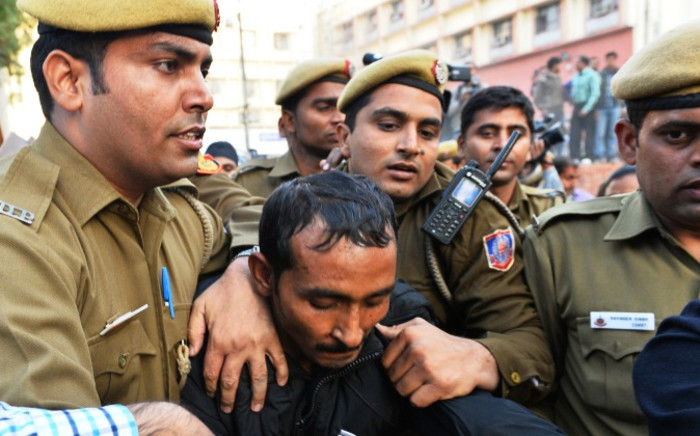 Indian police escort Uber taxi driver and accused rapist Shiv Kumar Yadav (C) following his court appearance in New Delhi on 8 December, 2014.