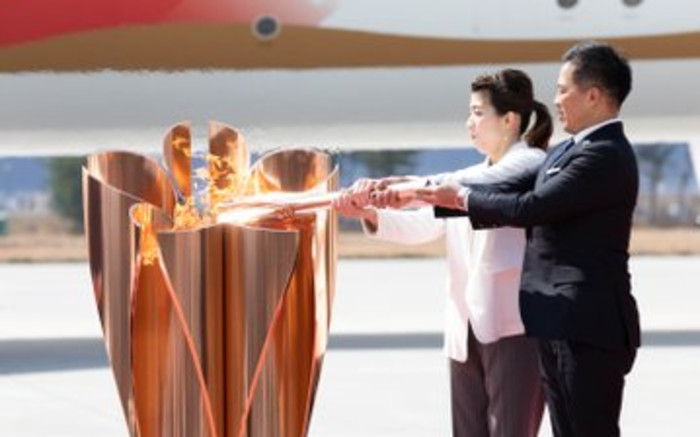 Thousands flock to see Olympic flame in Japan despite virus fears - EWN