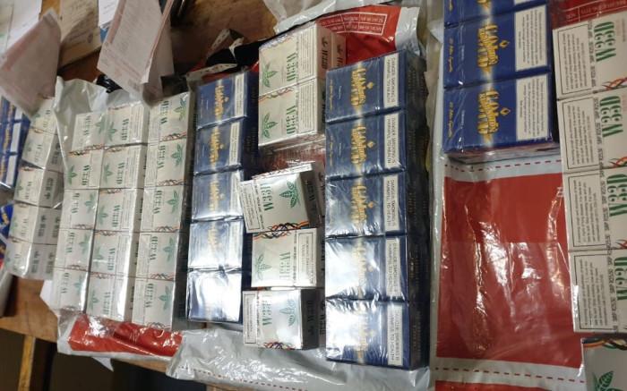 Hawks swoop on warehouse in Mokopane seizing 42 boxes of illicit cigarettes - EWN