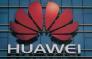 The Huawei logo stands on a Huawei office building in Dongguan in China's southern Guangdong province on 18 December 2018. Picture: AFP