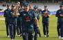 England's Chris Woakes is applauded by teammates as he leaves the pitch with the match-ball having taken five wickets in the fifth One Day International (ODI) cricket match between England and Pakistan at Headingley in Leeds, northern England on 19 May 2019. Picture: AFP