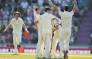 England's Sam Curran celebrates teammates after trapping India's Ravichandran Ashwin leg before wicket (LBW) to win the test match on the fourth day of the fourth Test cricket match between England and India at the Ageas Bowl in Southampton, southwest England on 2 September 2018. Picture: AFP.