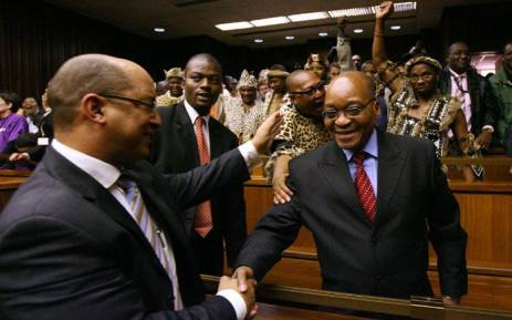 FILE: Jacob Zuma (right) is congratulated by his attorney Michael Hulley as he is found not guilty of rape in the Johannesburg High Court on 8 May 2006. Picture: AFP.