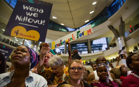 South Africans gathered at the OR Tambo International Airport to welcome the Ndlovu Youth Choir after they came in second on 'America's Got Talent'. Picture: Kayleen Morgan / EWN.