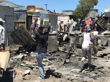 Masiphumelele residents salvage what they can in the aftermath of a fire on 18 December 2020. Picture: Kevin Brandt/EWN