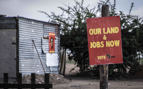 An elections poster of EFF leader Julius Malema on the fence of one of plots that belong to a resident of Juju Valley in Polokwane, Limpopo. Picture: Abigail Javier/EWN