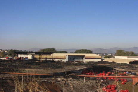 4 July 2021: A section of eSwatini's largest beverage company in Matsapa was burnt down. Residents say armed forces shot people and burned their remains in the fire. Now soldiers guard the site Picture: Magnificent Mndebele/New Frame