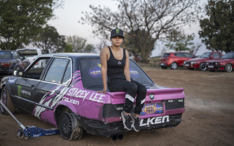 World-famous spinner Stacey-Lee May poses for a portrait seated on her car at a spinning event in Alberton, on 23 September 2021. Picture: Michele Spatari/AFP