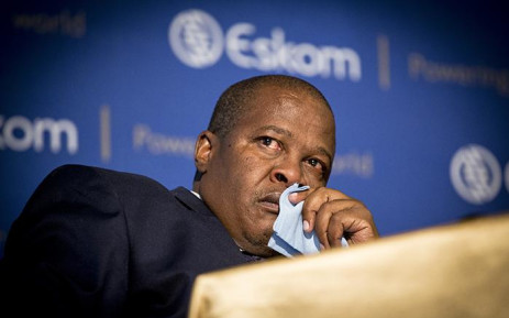 Eskom CEO Brian Molefe holds a napkin in his hands after tearing up after discussing former Public Protector Thuli Madonsela's State of Capture report during a press conference in Johannesburg on 3 November 2016. Picture:  EWN.
