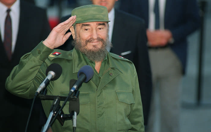 This file photo taken on 12 October 1995 shows Cuban President Fidel Castro saluting journalists. Picture: AFP.