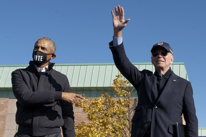 Former US President Barack Obama (L) joins Democratic presidential candidate Joe Biden at a campaign event in Flint, Michigan, on 31 October 2020. Picture: AFP.