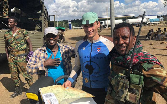 Alex McMaster and Merlin Hetherington pose with Ethiopian soldiers. Picture: Supplied