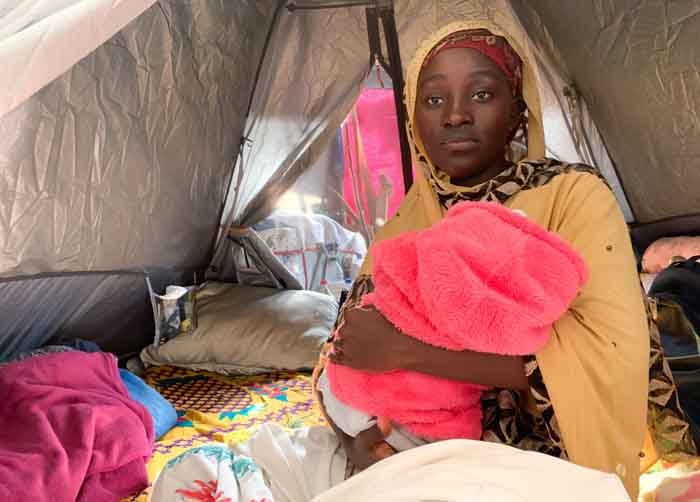 Refugee Fatuma Rukundo with her two-month-old baby inside their tent at the Wingfield military site in Goodwood where more than 800 refugees have been living since lockdown began. Picture: Kaylynn Palm.EWN