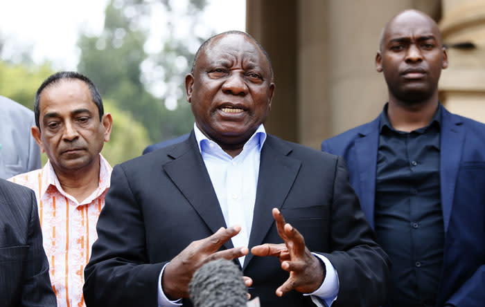 South African President Cyril Ramaphosa (C) conducts a media briefing at the end of a meeting with various business leaders and political party leaders on matters relating to the COVID-19 outbreak at the Union Buildings in Pretoria on 22 March 2020. Picture: AFP