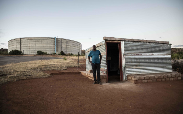 Thabiso Mokgatjana lives next to the big reservoir but doesn't benefit from it. He is forced to buy his own water. Picture: Abigail Javier/EWN