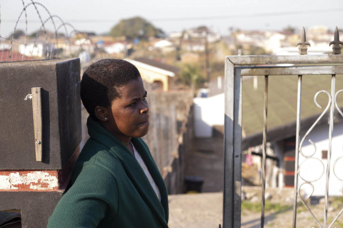Philisiwe Mhlongo has lived in Lenham, Phoenix, for 21 years. She works as a street cleaner under the expanded public works programme and is one of two breadwinners in her extended family.
