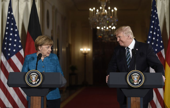 US President Donald Trump and German Chancellor Angela Merkel hold a joint press conference in the East Room of the White House in Washington, DC, on 17 March, 2017. Picture: AFP.