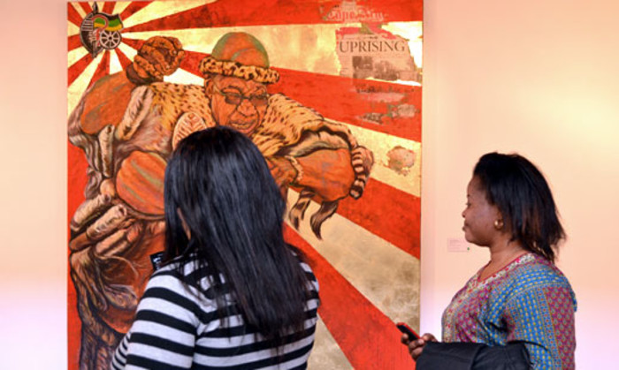 Gallery visitors take cellphone pictures of the painting entitled Umshini Wam by Ayanda Mabulu on 28 August 2012. Picture: Aletta Gardner/EWN