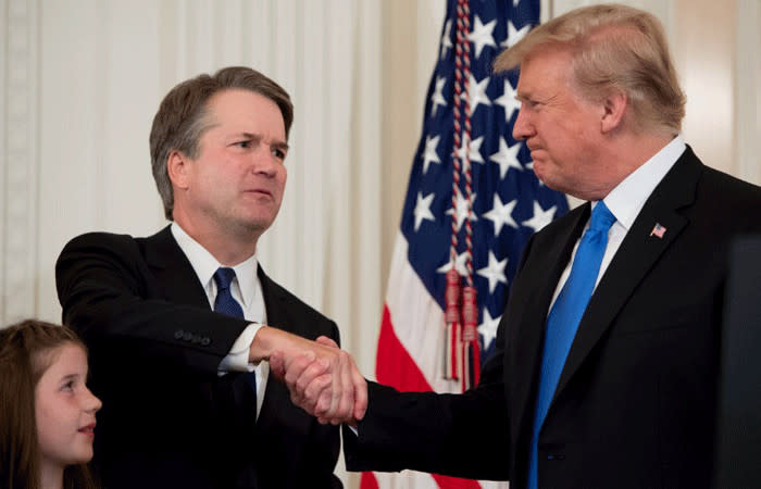 US Judge Brett Kavanaugh shakes hands with US President Donald Trump after being nominated to the Supreme Court in the East Room of the White House on 9 July, 2018 in Washington, DC. Picture: AFP