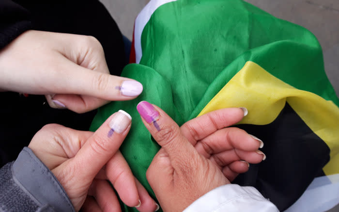 Voters abroad show off their inked thumbs. Picture: Supplied.