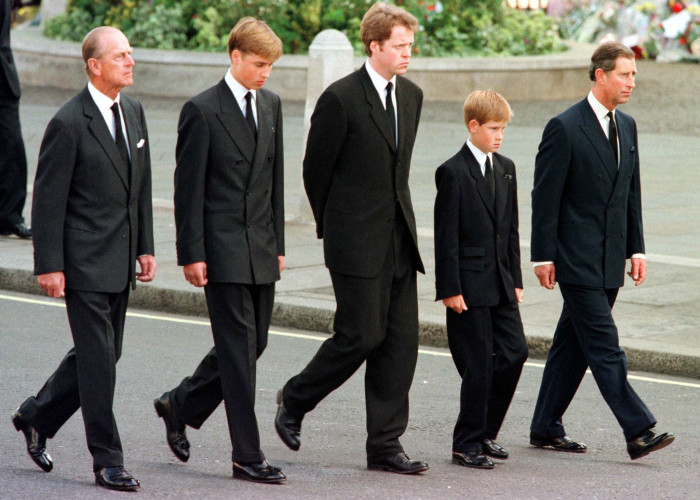 In this file photo taken on 6 September 1997 (L to R) Britain's Prince Philip, Duke of Edinburgh, Prince William, Earl Spencer, Prince Harry and Prince Charles, Prince of Wales, walk outside Westminster Abbey during the funeral service for Diana, Princess of Wales. Picture: JEFF J MITCHELL/POOL/AFP