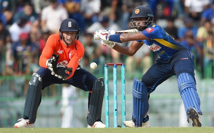 Sri Lankan cricketer Sadeera Samarawickrama (R) is watched by England wicketkeeper Jos Buttler (L) as he plays a shot during the fifth and final one day international (ODI) cricket match between Sri Lanka and England at the R. Peremadasa Stadium in Colombo on 23 October 2018.  Picture: AFP