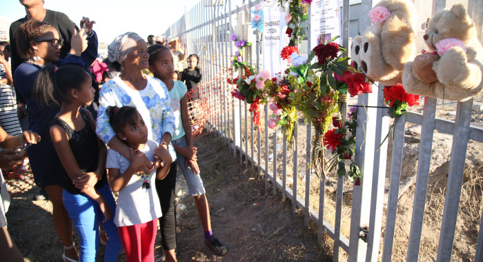 Elsies River community members gather near the area where the body of three-year-old Courtney Pieters was found. Picture: Bertram Malgas/EWN.