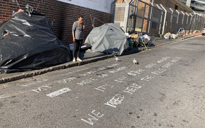 Andiswa Jacobs with the sign she painted on Tramway Road in Sea Point after her three-year-old son was removed by police and a social worker in her absence on 31 May 2021. Picture: Haji Mohamed Dawjee