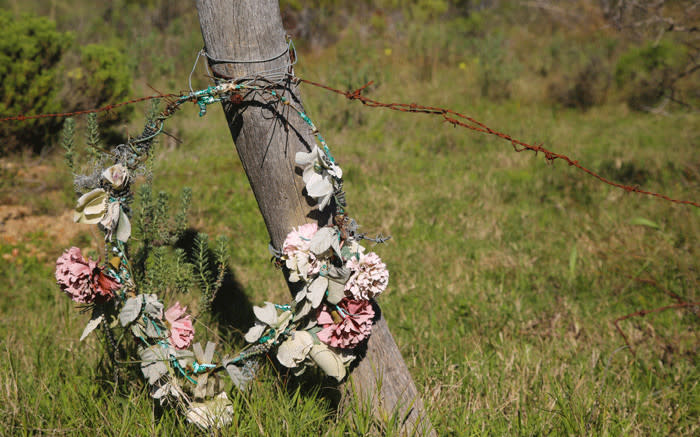 A weathered wreath, laid for little Kayde Williams, another victim of violence in Bredasdorp Picture credit: Kaylynn Palm/EWN.