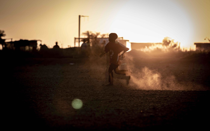 A child plays soccer in Juju Valley, an informal settlement in Polokwane, Limpopo. Picture: Abigail Javier/EWN
