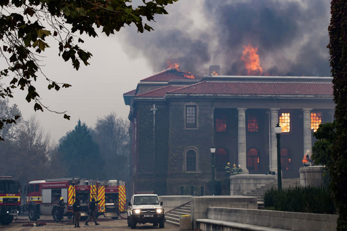 Firefighters try, in vain, to extinguish a fire in the Jagger Library, at the University of Cape Town, after a forest fire came down the foothills of Table Mountain, setting university buildings alight in Cape Town, on 18 April 2021. Picture: Rodger Bosch/AFP