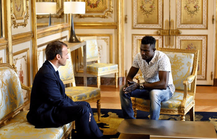 French President Emmanuel Macron speaks with Mamoudou Gassama, 22, from Mali, at the presidential Elysee Palace in Paris, on 28 May 2018. Picture: AFP