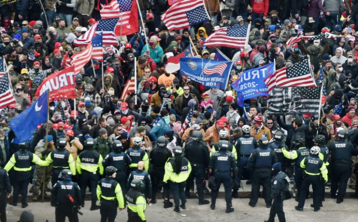 Trump supporters clash with police and security forces as they storm the US Capitol in Washington, DC on 6 January 2021. Donald Trump's supporters stormed a session of Congress held to certify Joe Biden's election win. Picture: AFP
