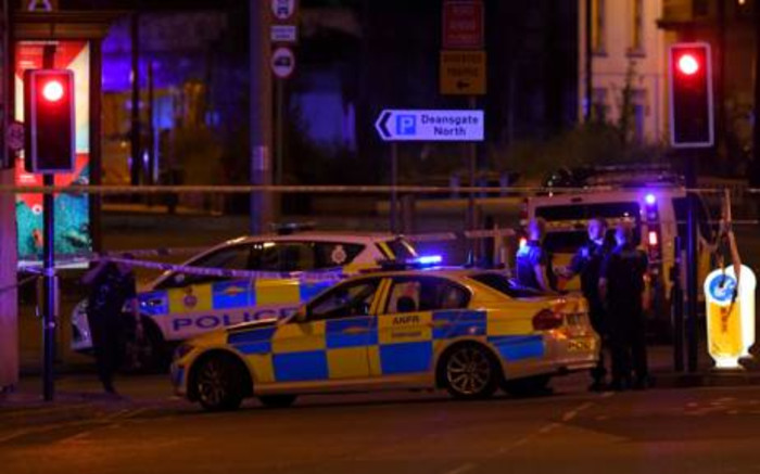Police deploy at the scene of an explosion in Manchester, England, on 23 May 2017 at an Ariana Grande concert. Picture: AFP.
