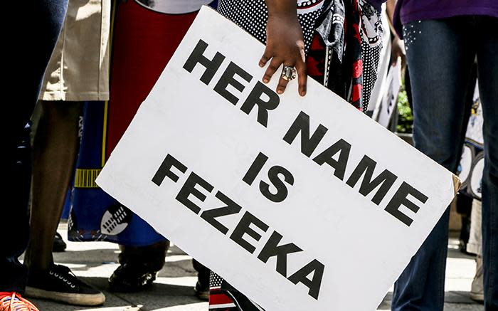 A woman holds a placard during a #HerNameIsFezeka march on 2 November 2016 in remembrance of Fezeka Ntsukela Kuzwayo, known as Khwezi, who accused President Jacob Zuma of rape in 2005. Picture: Reinart Toerien/EWN