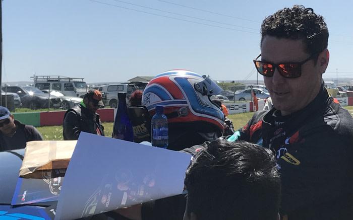 Engen Audi's Michael Stephen sign fans' pictures after winning Sasol GTC races. Picture: Kevin Brandt/EWN.
