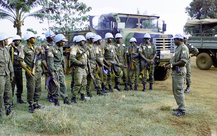 United Nations peacekeepers from Mali are briefed before their patrol during elections in Bangui in the Central African Republic in 1998. Picture: UN Photo